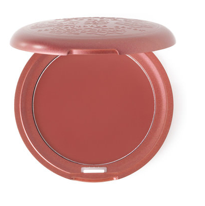 Opened, circular shaped Stilla blush case holding a dark pink blush