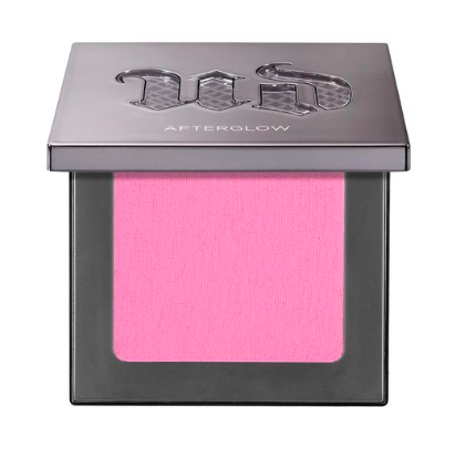 A grey, square shaped and half way opened Urban Decay case with hot pink blush inside