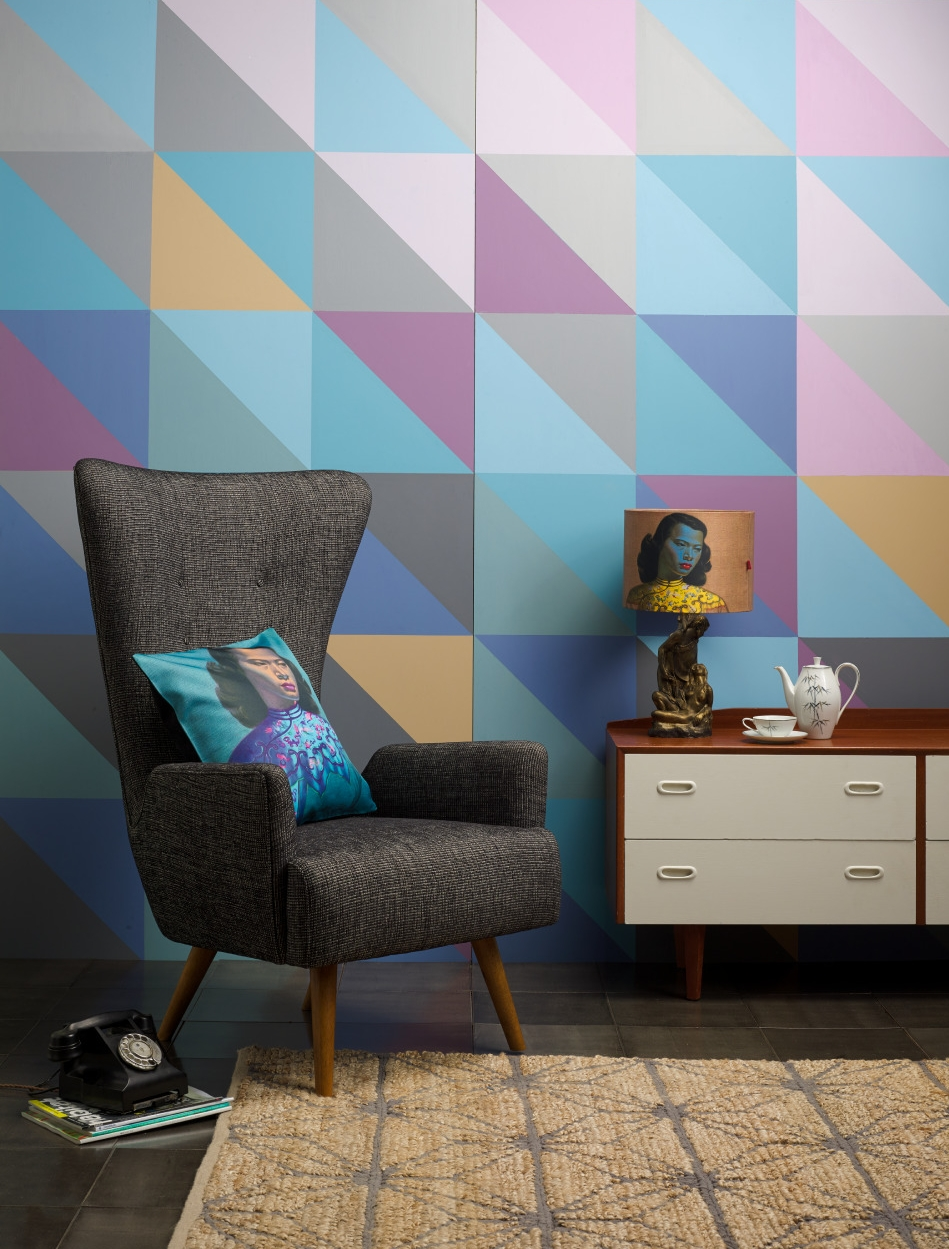Colours used for triangle mural: Resene Steam Roller, Resene Half Raven, Resene Melodic, Resene Mozart, Resene Essence, Resene Whirlwind, Resene Nauti, Resene Reflection, Resene Castaway. Sideboard drawers: Resene Bianca. Cork flooring in Resene metallic Range Blast Grey 1 created by Cork in Colour. From   Resene ColorShops  .