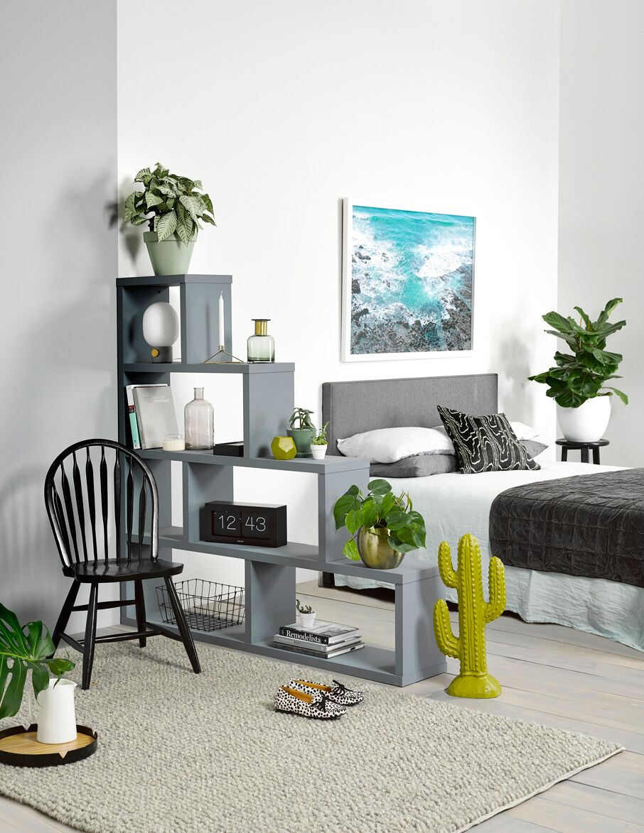 Walls: Resene Sea Fog and Resene Half Grey Chateau. Shelving unit: Resene Steam Roller. Floorboards: Resene Colorwood Greywash. Chair and plant stand: Resene Nero. Top pot: Resene Organic. Cactus and vase: Resene Grass Hopper.  Pot: Resene Rivergum. From   Resene ColorShops  .