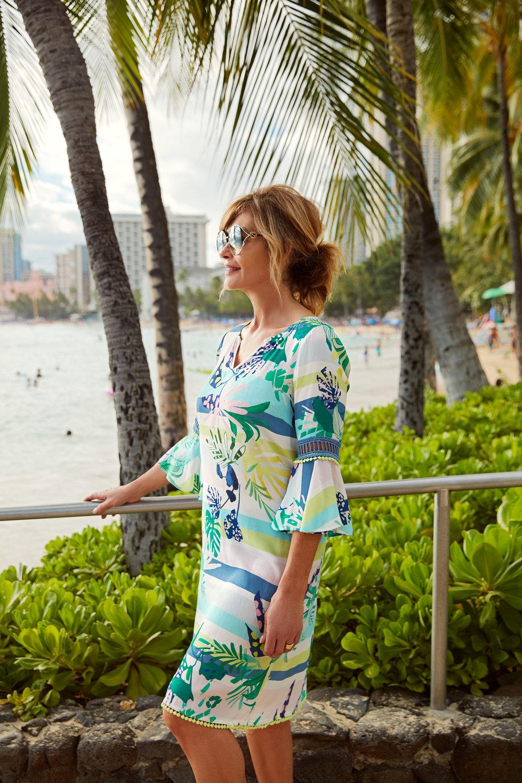 Trudi Brewer wearing   Madly Sweetly   Jungle Carnival dress, $239 and   Gucci   0225 sunglasses, $745. Photographed on location at Waikiki beach, Hawaii.
