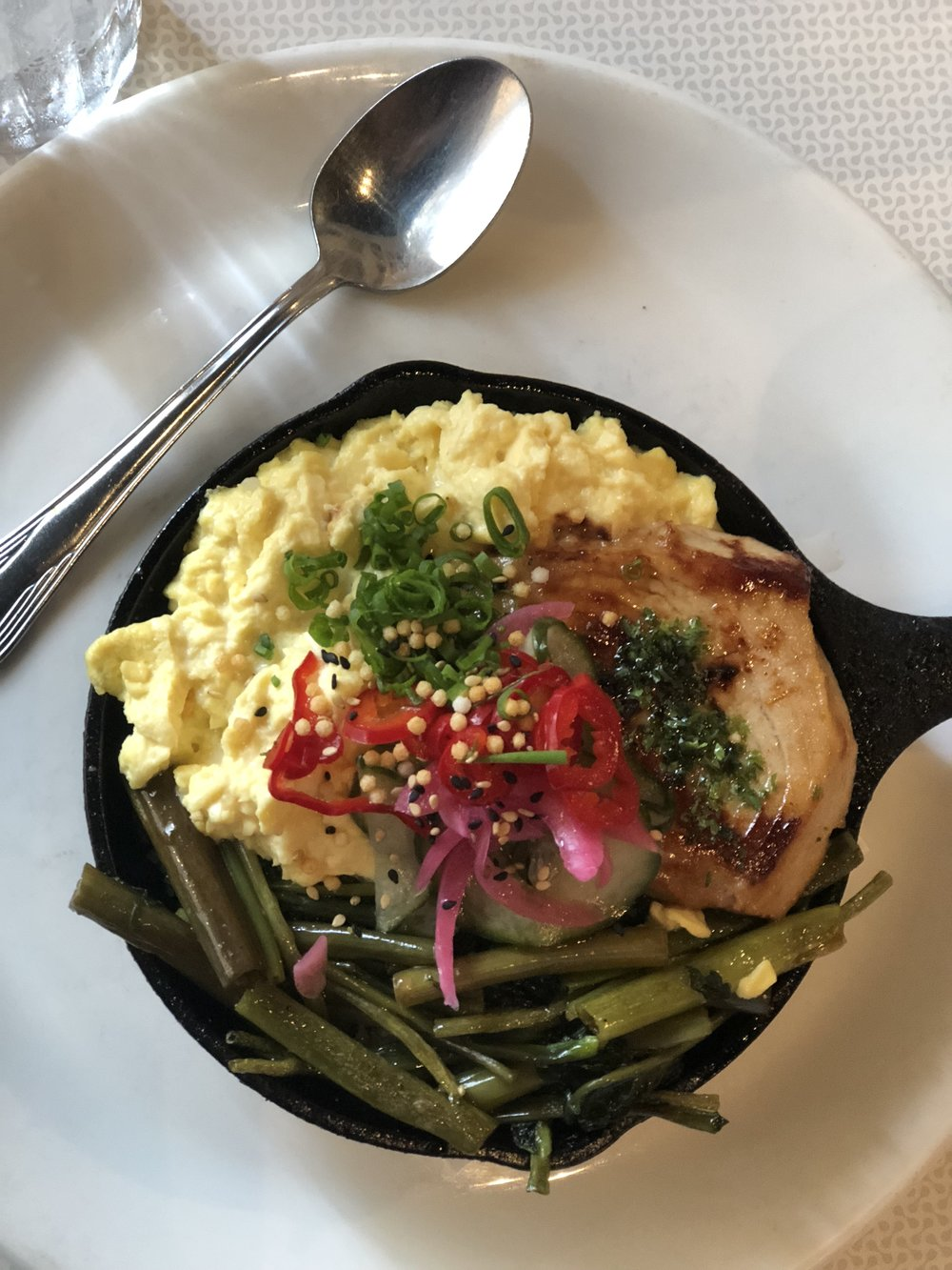 Eggs, fish and greens with homemade pickles for brunch.