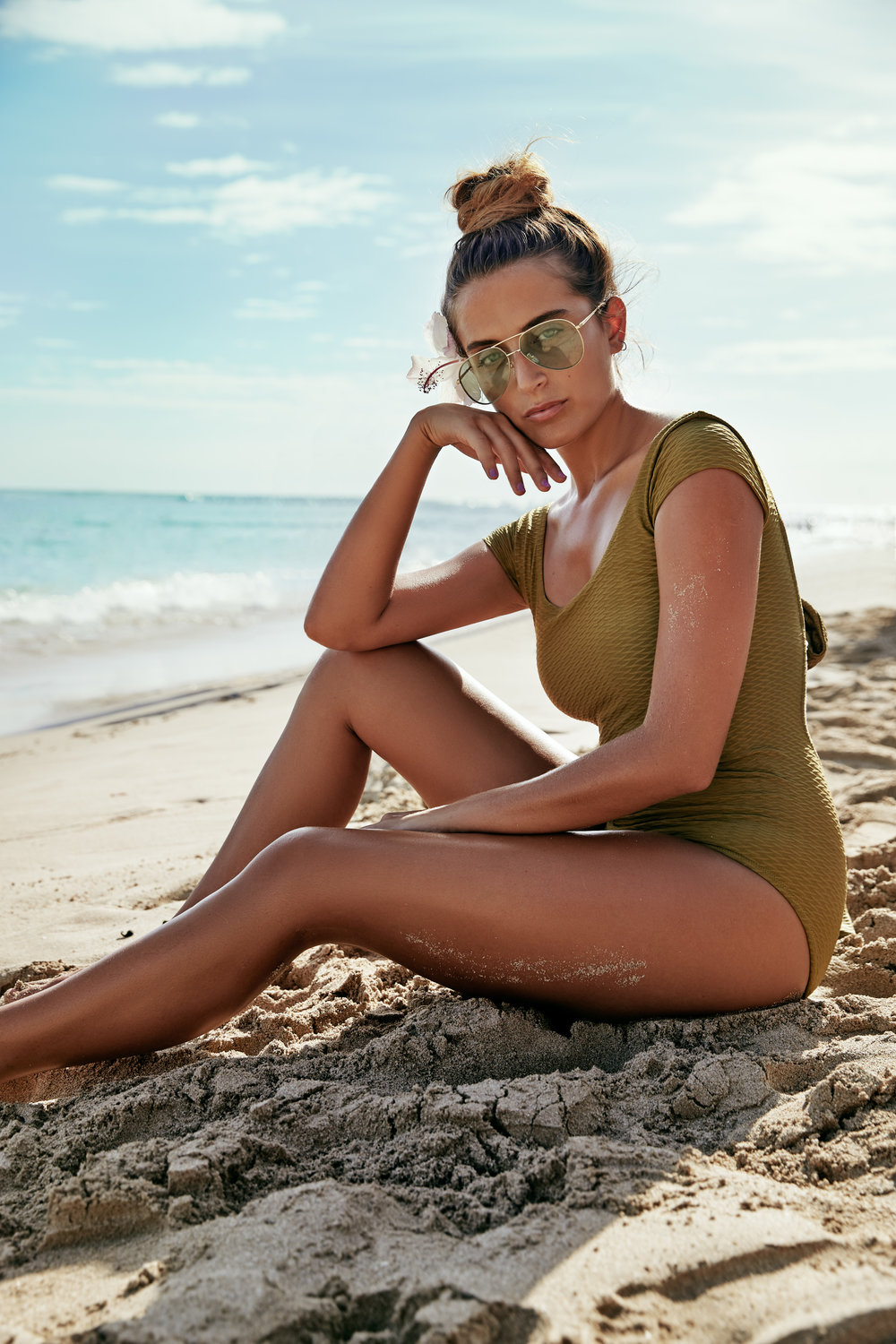 Model wears:  ST Tropez  Self Tan Extra Dark Bronzing Mousse,  Lonely  Connie swimsuit, $240 and  Gucci  Aviator sunglasses, $615. Photographed on location at Waikiki beach, Hawaii.