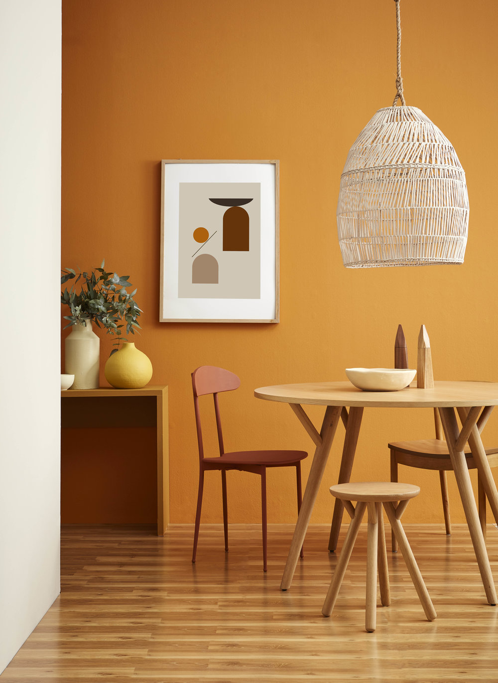 Wall in Resene Twisted Sister. Side wall in Resene Half Spanish White. Floor in Resene Colorwood Natural. Sideboard in Resene Swiss Caramel. Pendant light in Resene Spanish White. Chair in Resene Moccasin