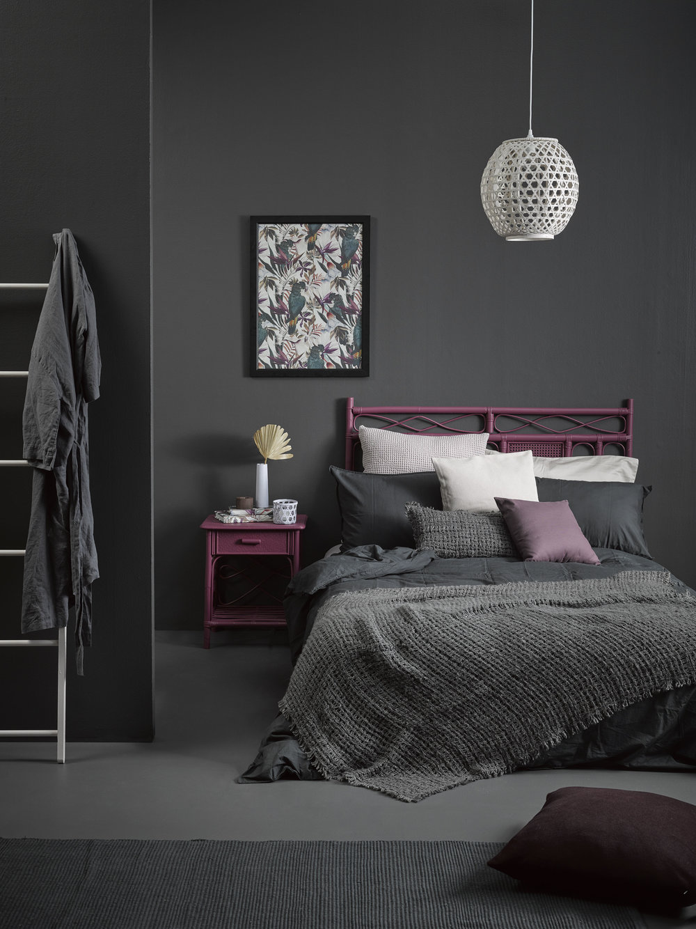 Wall in Resene Quarter Bokara Grey. Floor in Resene Eighth Bokara Grey. Cane headboard and side table in Resene Virtuoso. Pendant light and ladder in Resene Ethereal. Slender vase, tea light and hex wall planter in Resene Dreamtime. Cork tealight holder in Resene Rebel