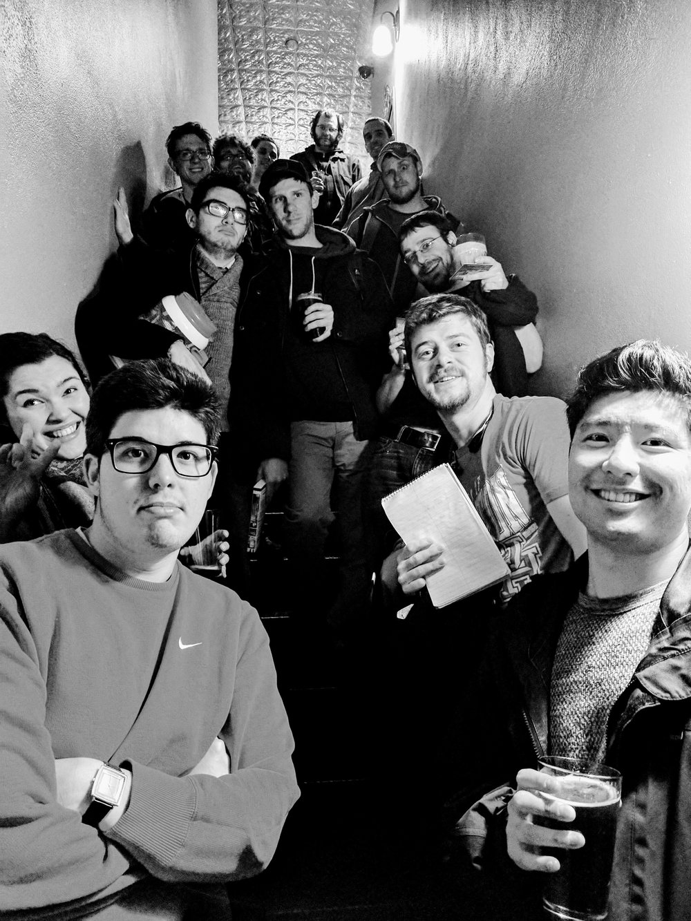 The crew waiting, notebooks in hand, to get into the Argus Underground Open Mic!