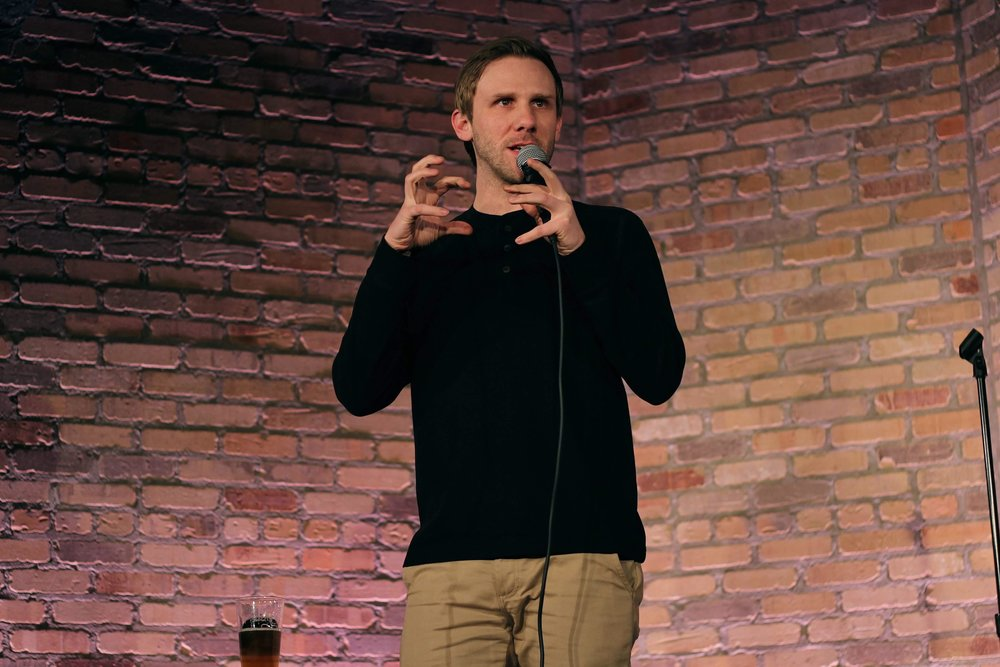 Adam McShane - Adam McShane began doing stand-up in Madison, WI and quickly became recognized around town for his sharp observational comedy on subjects that