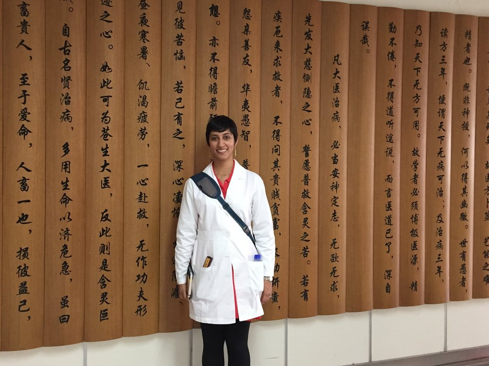 Photo of Shawna at the new Tianjin Hospital in China in front of Sun Si Miao's Oath