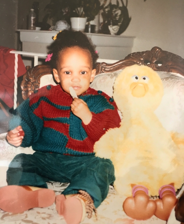I'm basically doing the same thing right now as I am in this picture except my afro is bigger, my sweater/pant color scheme is white-black-gray, and my version of Big Bird is George...