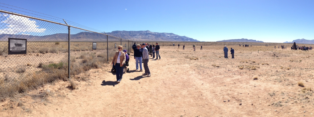 My view of the Trinity test site during the April 2 open house. A photo of the mushroom cloud is posted on the fence to the left; the 12-foot ground zero obelisk is in the distance to the right