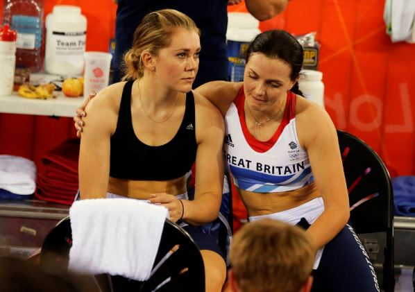 Jessica Varnish, left and Victoria Pendleton after being disqualified after the track cycling women's team sprint qualifying