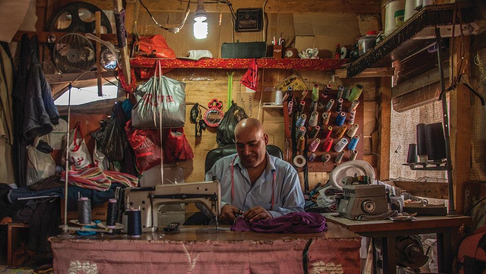 A Syrian refugee tailor, Lebanon.jpg