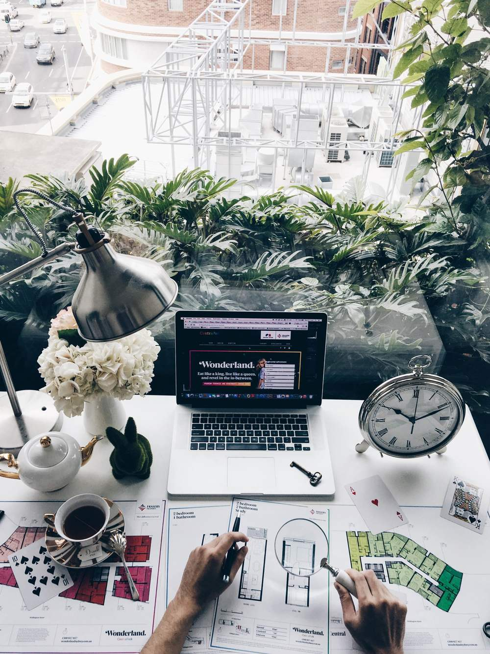 I am usually the most productive when my work space is filled with lots of natural light away from all the noise pollution from the city. You'd think that living in the city would be loud and noisy, but behind these transparent walls I don't hear a thing.    I love working from behind these vertical hanging gardens and I always feel inspired to keep on creating new content.