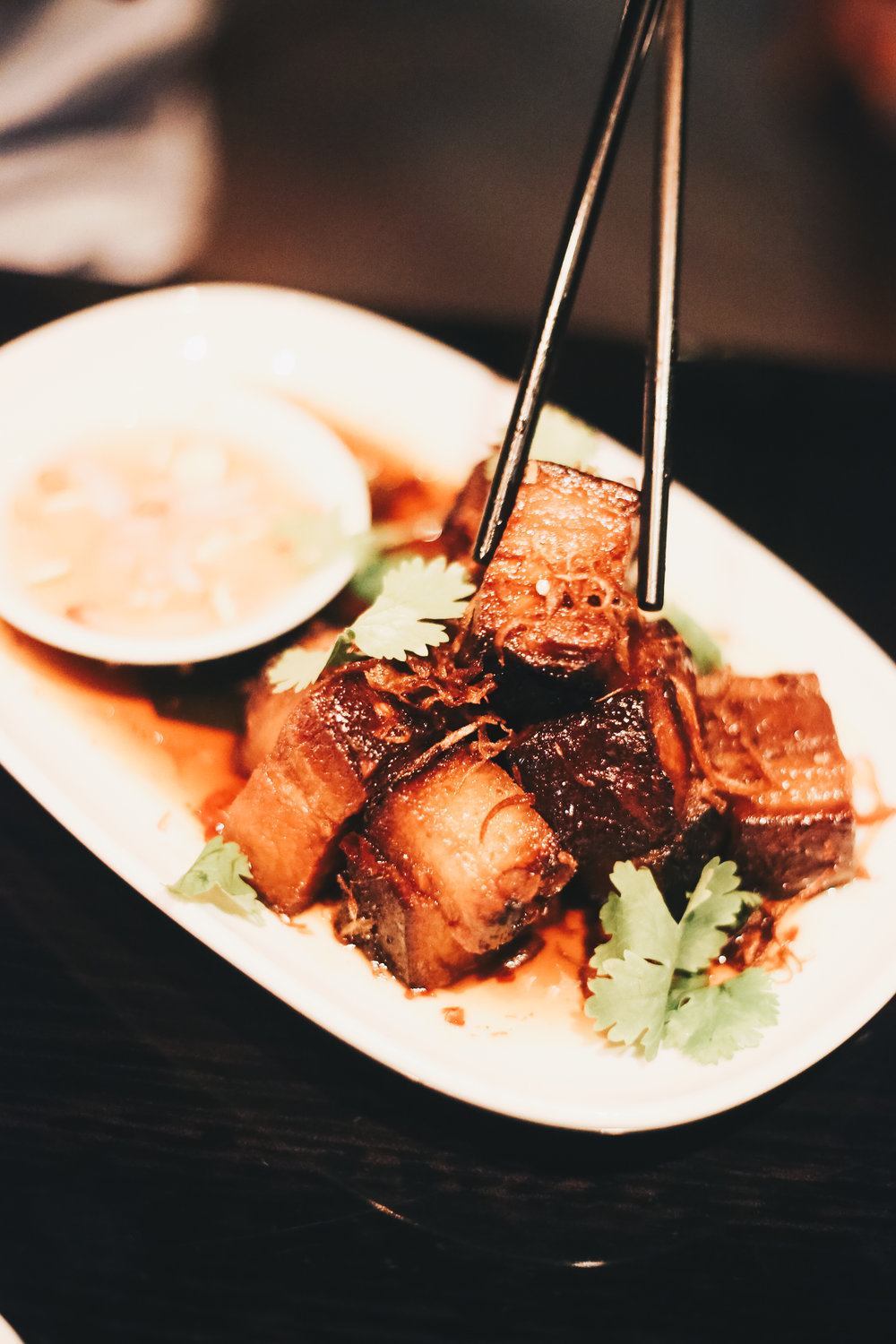 Soy braised crispy pork belly with chilli caramel.