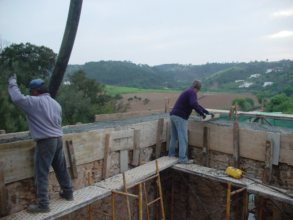 Pooring the concrete for the round beam on top of the old walls