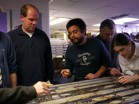 Kevin Kurtz looking at cores with geologists on the JOIDES Resolution.