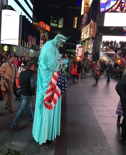 Photo by me of the Statue of Liberty checking her phone in Times Square