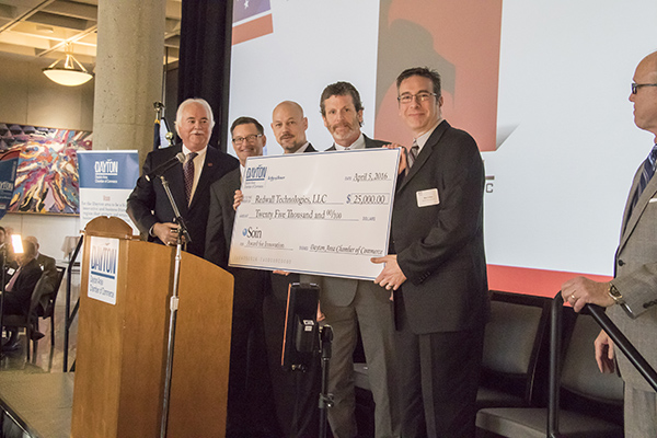 Last year's winners, Redwall Technologies LLC, accept the $25,000 check for winning the Soin Innovation Award.