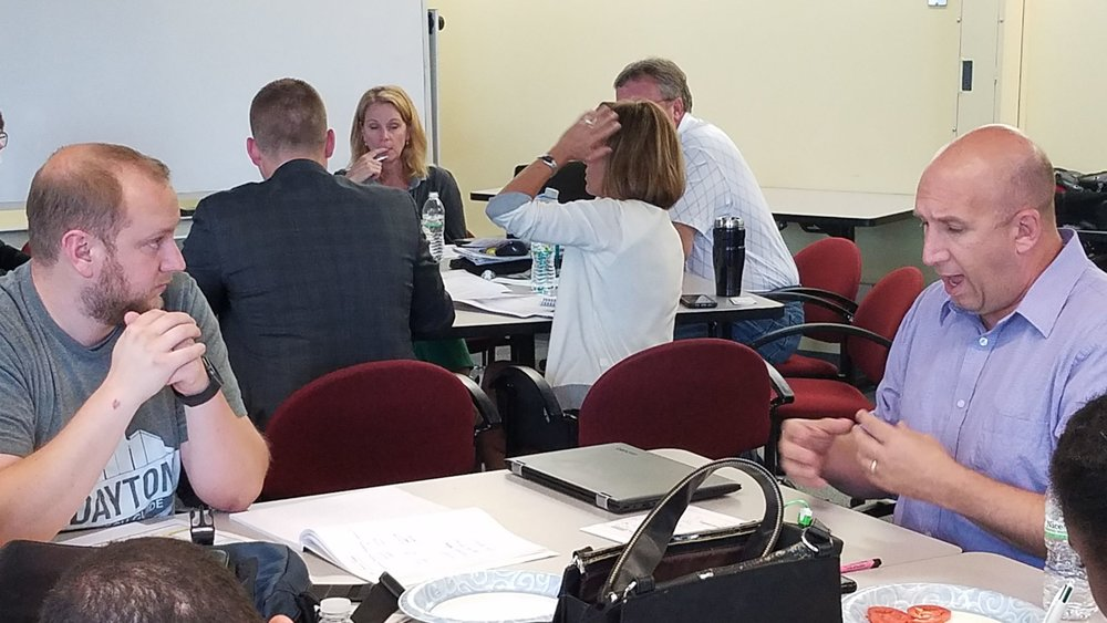 Co-creator of Wright State Research Institute's Dayton Tech Guide John Owen helps Catalyst Bootcamp participant to clearly state his value proposition during one of the afternoon's exercises.