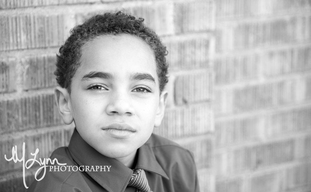 black and white head shot fine art child portrait bricks.jpg