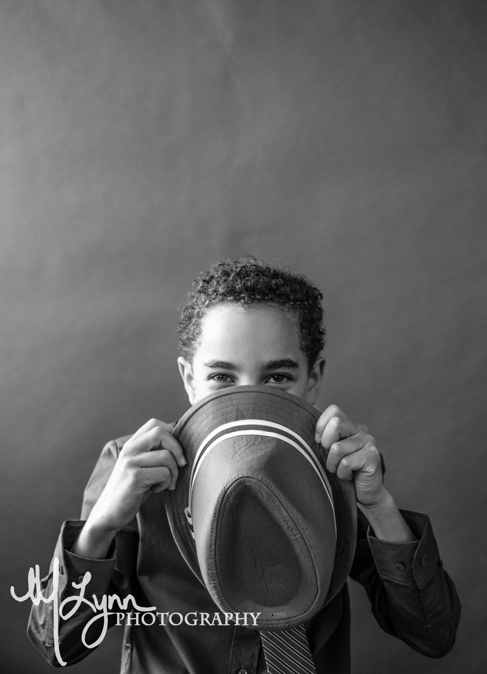 fine art boy child portrait peek a boo black and white.jpg