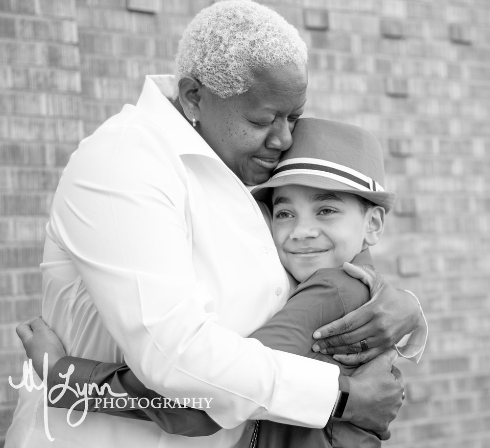 mother son fine art black and white portrait brick wall.jpg