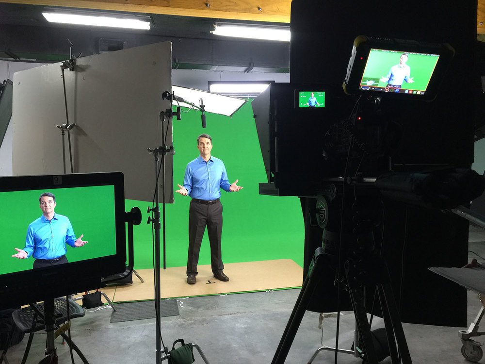 Green screen shoot with corporate spokesperson.