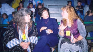 Granny Sue, Danny McMillion, & Karen Vuranch talk during a festival