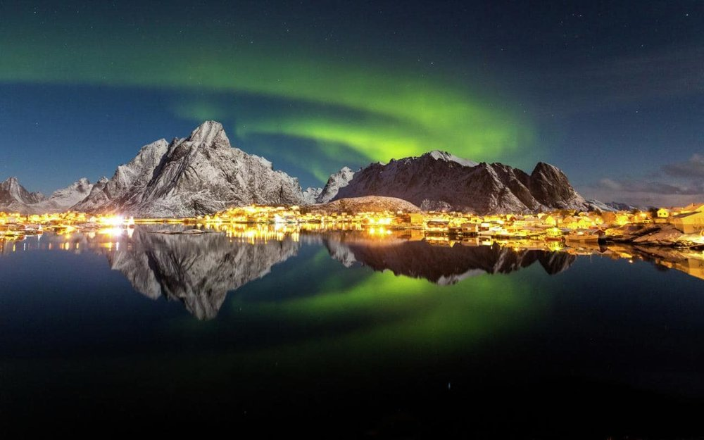 norway-northern-lighs-city-water-xlarge.jpg