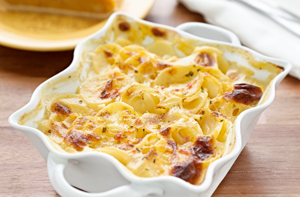 Four Cheese Potatoes - Four cheese scalloped potatoes - rich, creamy, mouthwatering.