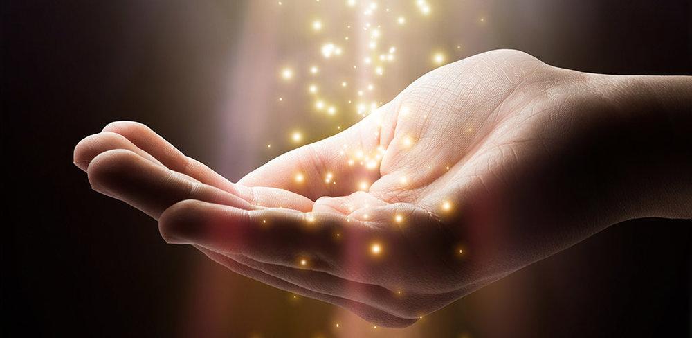 reiki hand with light.jpg