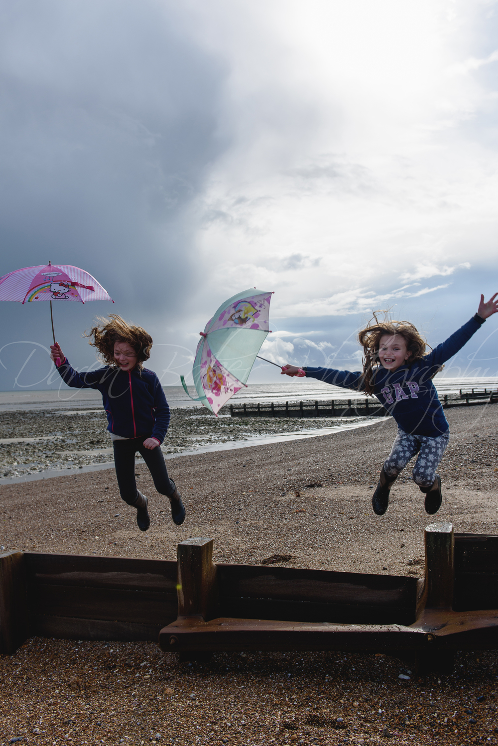 Beach in the rain, family shoot Sussex