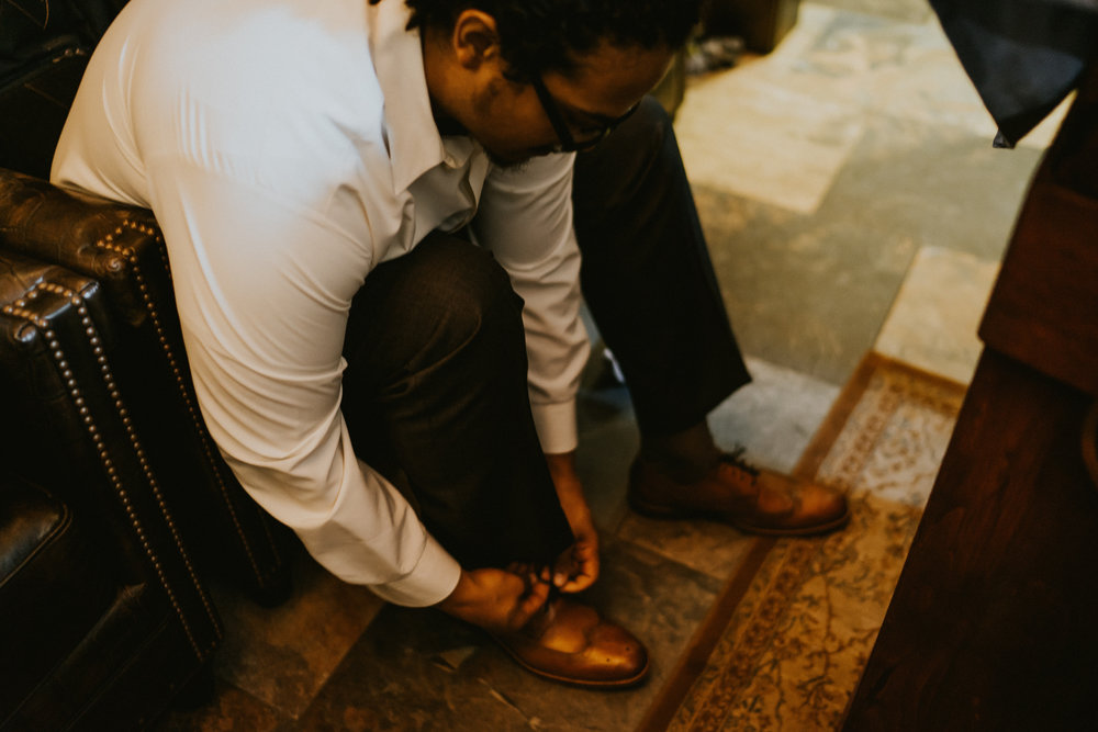 Groom shoes getting ready