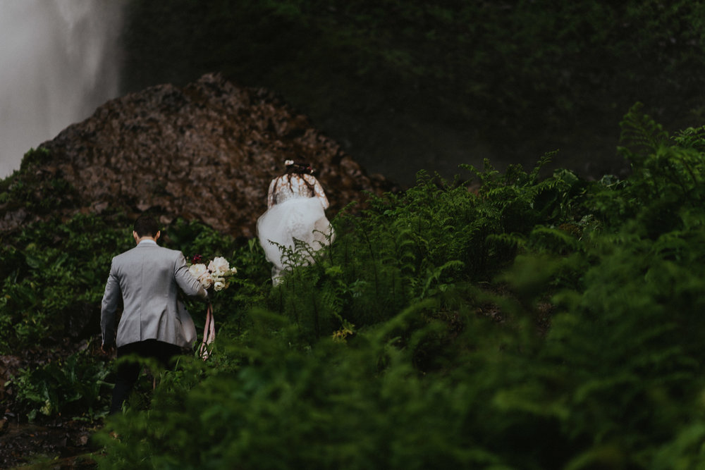Chasing-waterfalls-bride-candid-wedding-photography