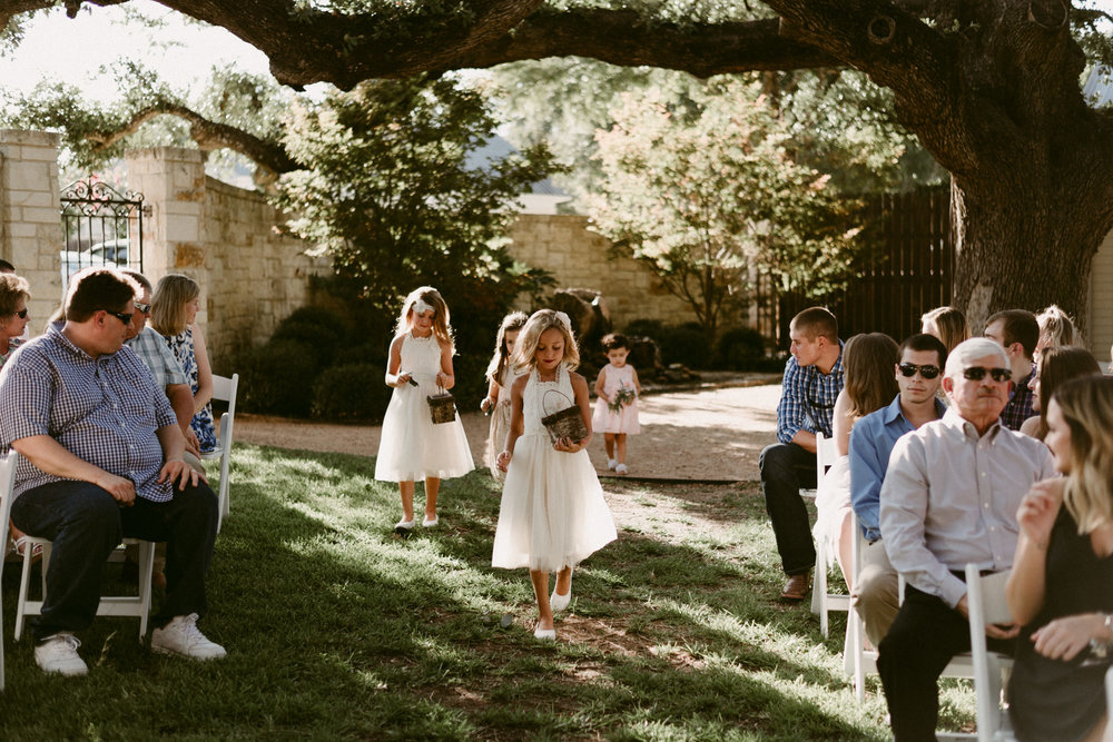 Intimate-Cathedral-Oaks-Wedding-Ceremony-Flower-Girls-Kerlyn-Van-Gelder-Photography-Austin-Wedding-Photographer