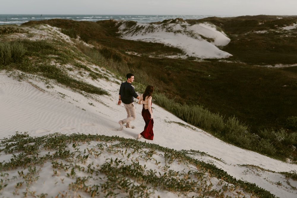 Intimate-Sunset-Windy-Beach-Engagement-Session-Kerlyn-Van-Gelder-Photography-Austin-Wedding-Photographer