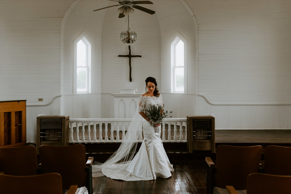intimate-emotional-white-church-bridal-session-lace-button-wedding-dress-three-rivers-texas-photographer-kerlyn-van-gelder-photography