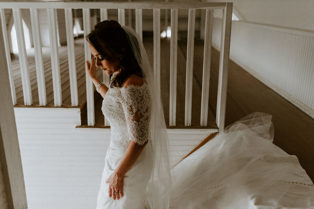 intimate-emotional-stained-glass-windows-white-church-bridal-session-lace-button-wedding-dress-three-rivers-texas-photographer-kerlyn-van-gelder-photography