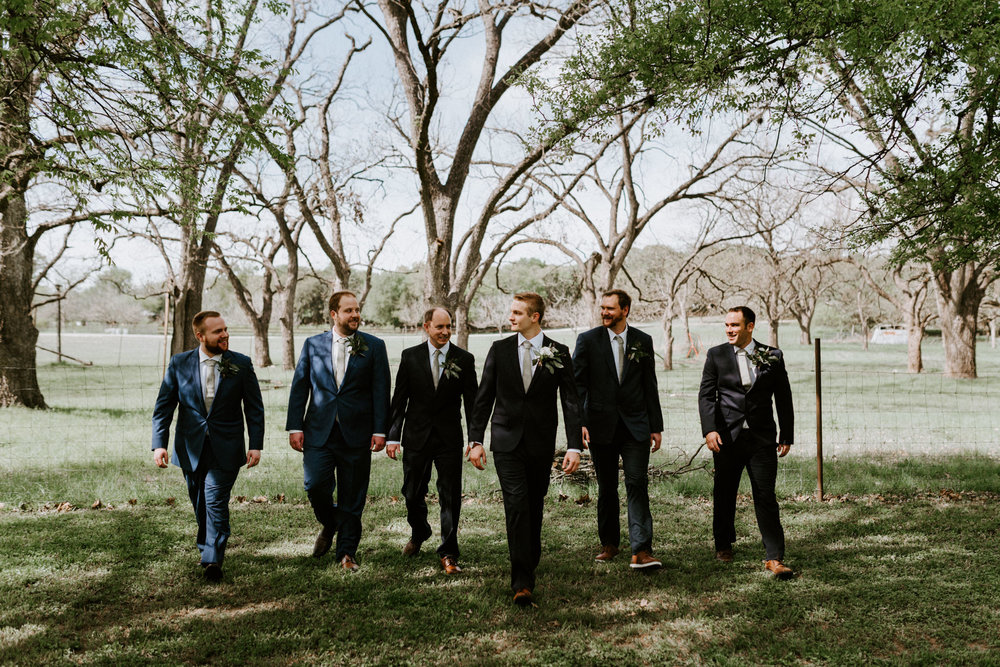 sunny-spring-wedding-wildflowers-log-cabin-groom-details-forest-the-waters-point-wimberley-texas-kerlyn-van-gelder-photography-austin-wedding-photographer