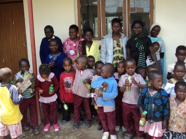 A group photo of some of the pupils with parents and teachers, taken in 2016.