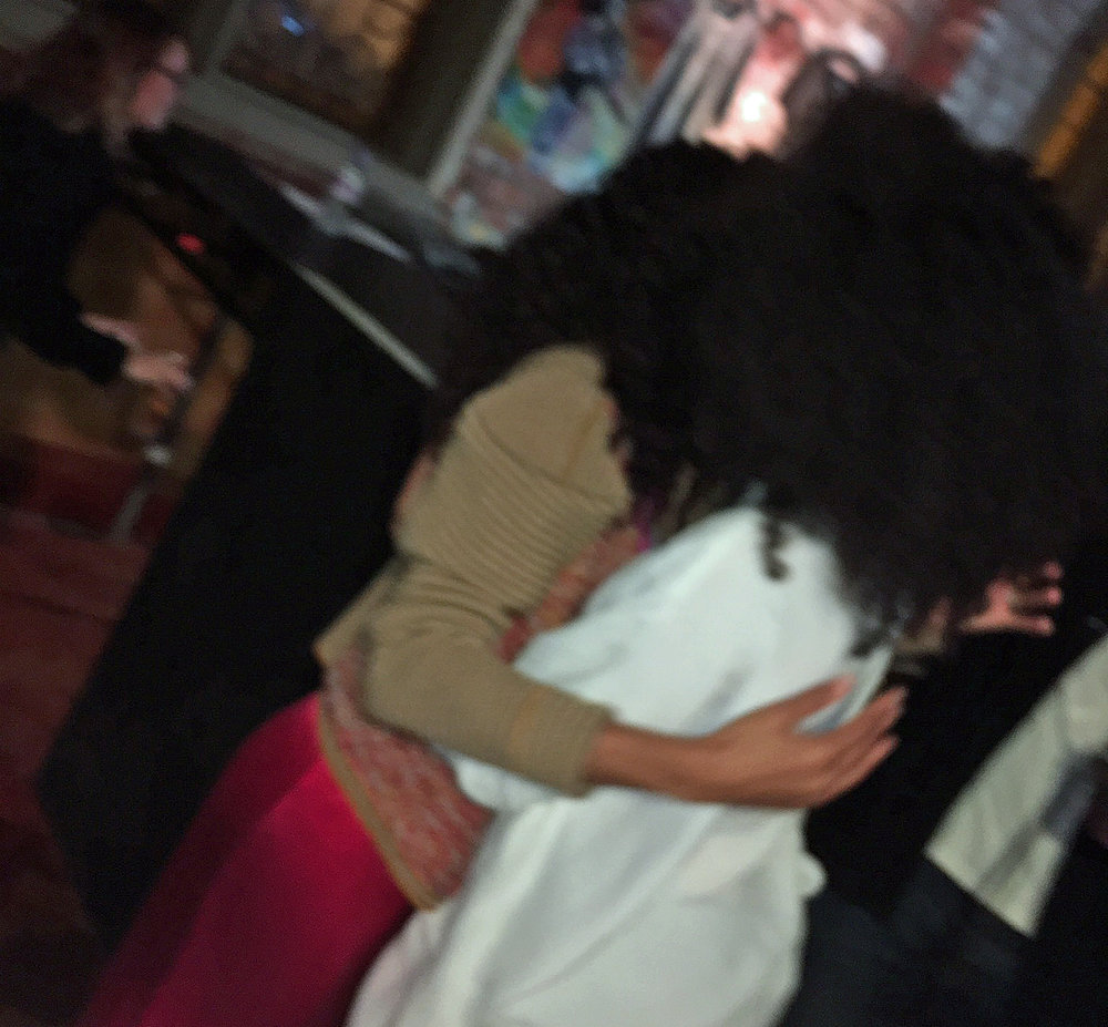 A blurry big hair hug from Corinne Bailey Rae