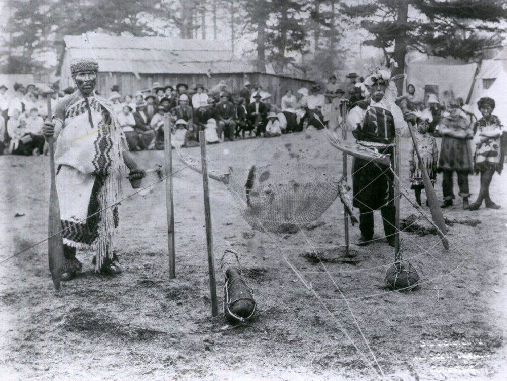 Lummi men demonstrate reef net fishing on Village Point c. 1914