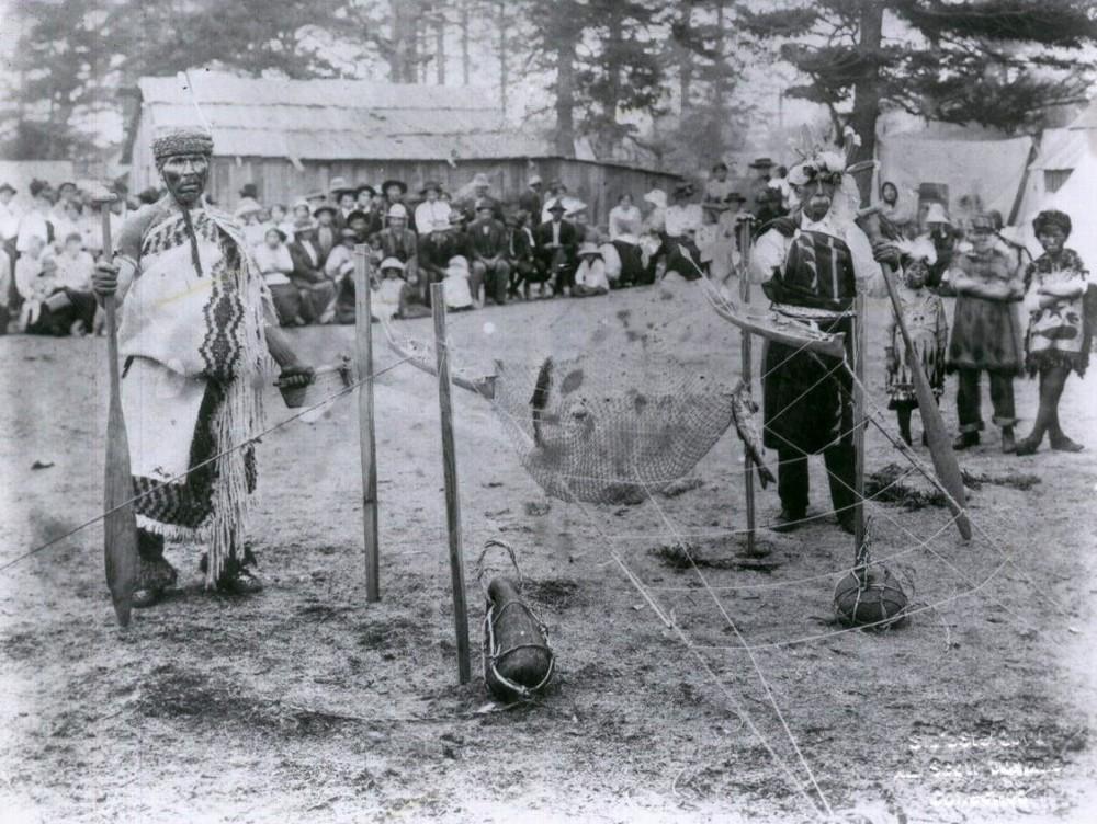Lummi men demonstrate reef net fishing on Village Point c. 1914