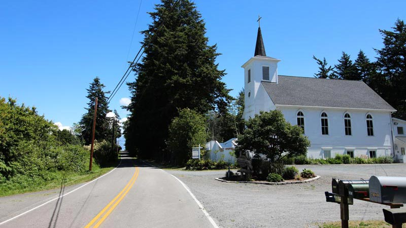 Legoe Bay Road, going by the church