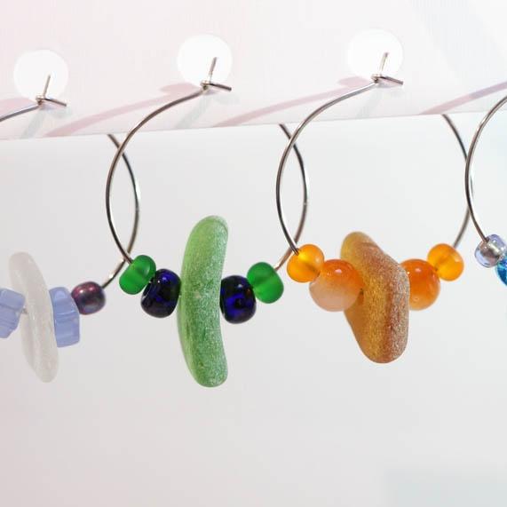 Sue-Aspelund-earrings-4-green-orange-close.jpg