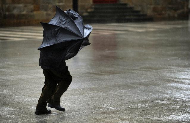man-in-rain-with-umbrella.jpeg