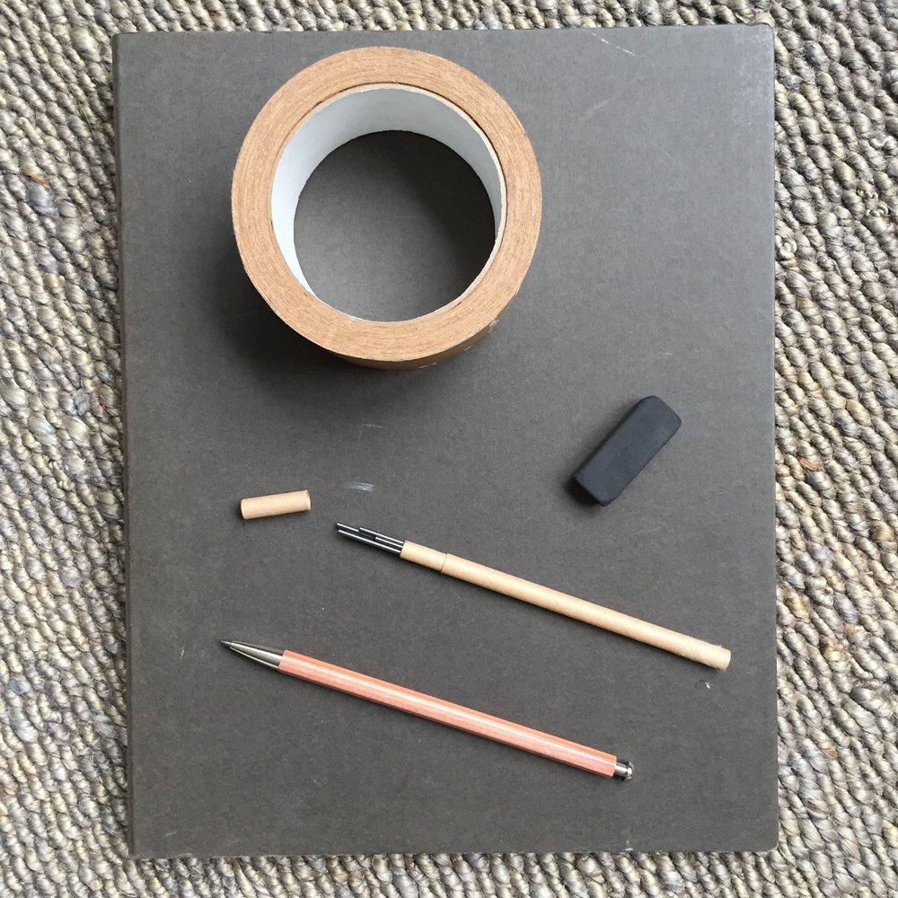MUJI recycled cardboard notebook and eraser,Kitaboshi wood & metal mechanical pencil and 2mm lead (in a cardboard sleeve), brown craft tape.