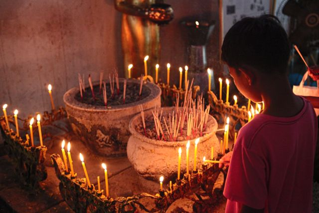 11 Boy Lighting Candles.jpg