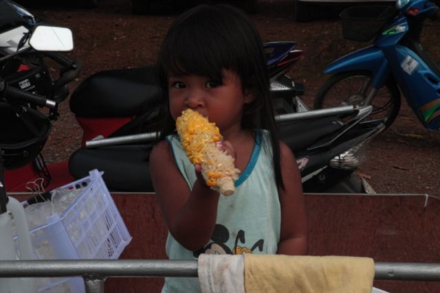 Kid eating Corn.jpg