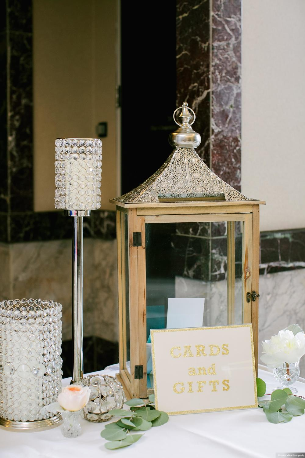 Photographer:  Jeannine Marie Photography | Event Venue: The Carlson Towers Rotunda and Amphitheatre | Caterer: Bon Appetit at Carlson Center | Floral & Event Designer: Whimsy Designs| Event Planner: Emily,  The Simply Elegant Group | Cinema and Video: J Walter Anderson Photo and Video  | Cake Designer: Queen of Cakes  | Hair Stylist: Sanctuary Salonspa | Makeup Artist:Sanctuary Salonspa | Tuxedo and Mens Attire: Savvi Formalwear | Dress Designer: Stella York | Dress Store: Charlotte's Bridal | Officiant: Grand Avenue Wedding Officiants | Other: International Cigars  | Photo Booth Equipment: The Photo Booth Group  | Invitation Designer: Wedding Paper Divas | DJ: Adagio Djay Entertainment